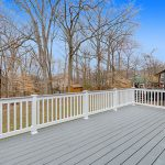a spacious back deck looking off into the woods