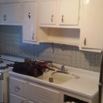 old white kitchen with gas stove